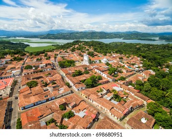 An aerial view of the historic and colonial town of Suchitoto with the Lempa river behind in El Salvador