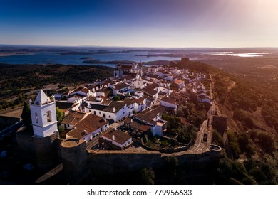 Aerial view of the historic village of Monsaraz in Alentejo with the Alqueva dam reservoir on the background; Concept for travel in Portugal and Alentejo