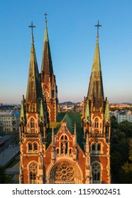 Aerial view of historical old city district of Lviv. The tower of the Church of Saints Olga and Elizabeth on a background of Lviv roof