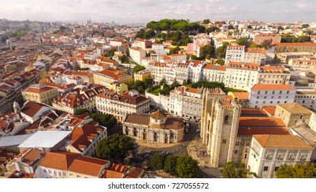 Aerial view of historical part of Lisbon and Lisbon Cathedral at sunny day Portugal