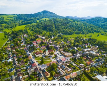 Aerial view of historical town Jiretin pod Jedlovou in Luzicke hory, Czech republic, European union. Mountains Krizova hora and Jedlova in behind.