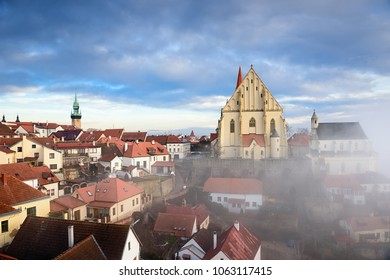 Aerial view of the historical town of Znojmo with St. Nicholas Church and St. Wenceslas chapel on a foggy winter day. Znojmo, Czech Republic, Europe.