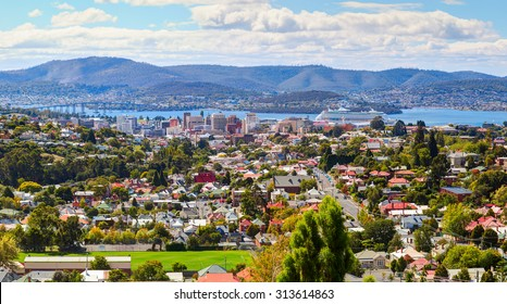 Aerial view of Hobart City. Large cruise ship is docked over horizon. Hobart City, Tasmanian Island. Australia.