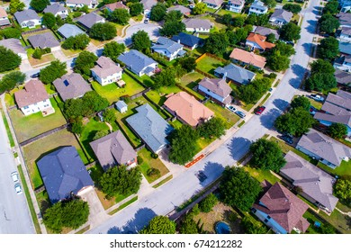 Aerial View of homes along curved modern residential layout drone photography of suburb outside of Austin , Texas , USA