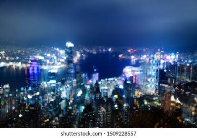 Aerial view of Hong Kong cityscape at night.