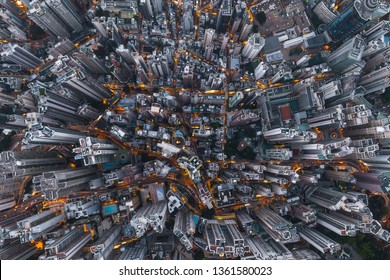 Aerial view of Hong Kong Downtown, Republic of China. Financial district and business centers in smart city in Asia. Top view of skyscraper and high-rise buildings at night.