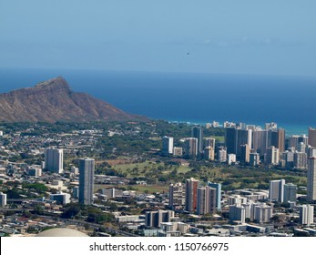 Aerial view of Honolulu Cityscape, Diamondhead, Ala Wai Golf Course, the gold coast, Pacific ocean, and waves with Helicopter in air on Oahu, Hawaii.  March 2016.