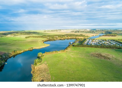 Aerial view of Hopkins River and Holiday Park at sunset in Warrnambool, Australia