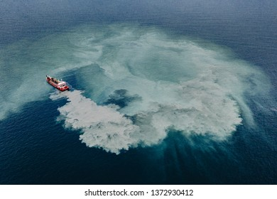 Aerial view of a hopper dredge collecting sand from the bottom of the ocean during a beach replenishment project