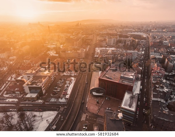 Aerial view of hospital with cityscape, sunset time, drone photo of medical center