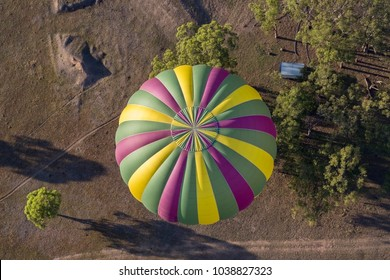 Aerial view of a hot air balloon and tree tops of farm land, Hunter Valley, Australia