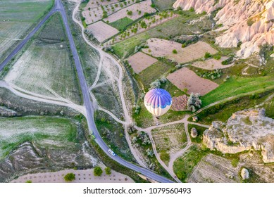 Aerial view of hot air balloon over landscape of Cappadocia, Turkey