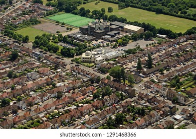 Aerial view of Hounslow Central Mosque and Heathland School in West London on a sunny summer afternoon.
