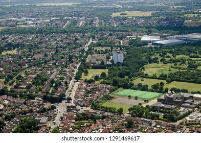 Aerial View of Hounslow in West London on a sunny summer afternoon.  Hounslow Heath is to the right hand side.