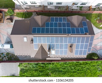 aerial view of house with solar roof. clean energy