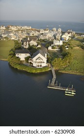Aerial view of houses and ocean at Bald Head Island, North Carolina.