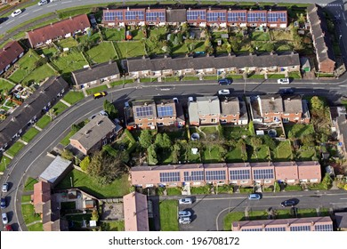 aerial view of houses on UK housing estates, some with solar roof panels