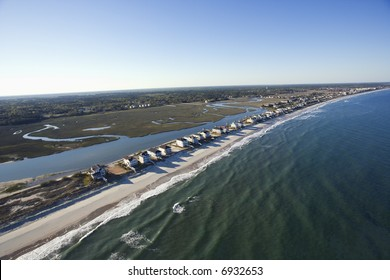 Aerial view of houses in row on beachfront of Pawleys Island, South Carolina.