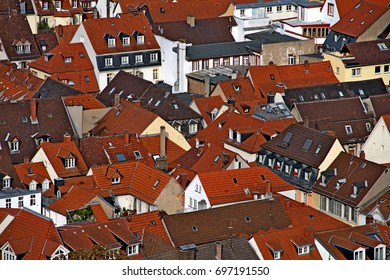 Aerial view of houses with traditional red roofs in Heidelberg.