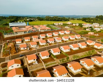 Aerial view of a housing estate (popular houses) in Paraná, Brazil.