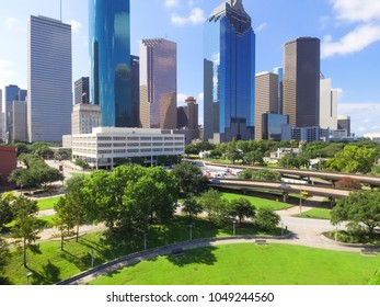 Aerial view Houston downtown and Gulf Freeway (highway I45). Daytime cityscape with cloud blue sky.