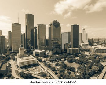 Aerial view Houston downtown and Gulf Freeway (highway I45). Daytime cityscape with cloud blue sky. Vintage tone.