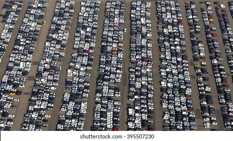 Aerial view of a huge car park in the Amsterdam harbour. The cars just got of a freight ship waiting to go to a dealership.