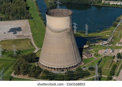 Aerial view of huge coolingtower from a coal and biomass fired powerplant at river Amer near Geertruidenberg, in The Netherlands.