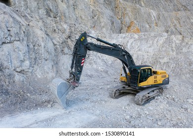 aerial view to huge mine bucket chain digger with bucket at stone quarry