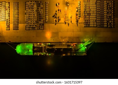 Aerial view of the huge ro-ro ship loading new cars. Automotive container carriers oversea services. Transportation business for prefabricated cars by sea freight