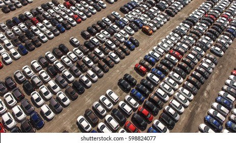 Aerial view of huge storage parking with new cars