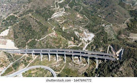 Aerial view of huge viaduct in the Spanish mountains. Highway A7 leads from Malaga in the direction of Sierra Nevada in a beautiful mountain landscape.