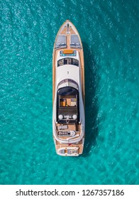 Aerial view of huge yacht at anchor on turquoise water, showing luxury, wealth, design, vessel and large ship