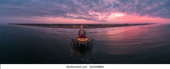 Aerial view of the Huntington Beach Pier in Huntington Beach, California at sunrise.