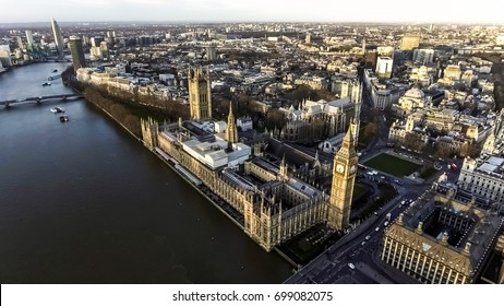 Aerial View of Iconic Landmark London Big Ben Houses of Parliament in Westminster feat Local Traffic, London Streets and River Thames with Beautiful Sunrise