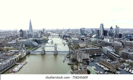 Aerial View Iconic Landmarks and Cityscape of London feat. Tower Bridge, Tower of London, City Hall, River Thames, The Shard Building, City of London Financial District and Skycrapers in 4K UHD