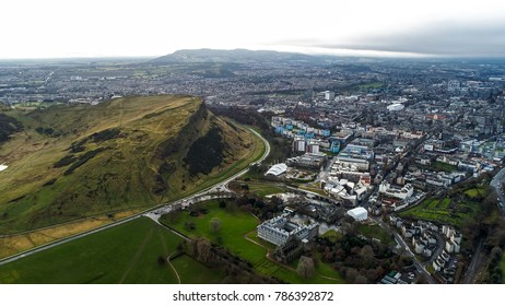 Aerial View Iconic Landmarks in Edinburgh Famous Arthur's Seat Hill, Modern Scottish Parliament Building, Holyrood Park and Palace in Scotland UK