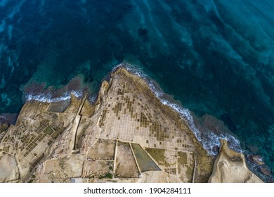 Aerial view to iconic salt pans of Malta island