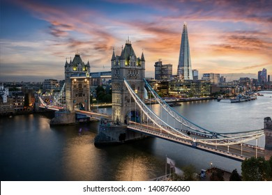 Aerial view to the illuminated Tower Bridge and skyline of London, UK, just after sunset - Shutterstock ID 1408766060