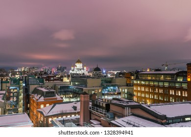 Aerial view to the iluminated city center of Moscow at night time. Christ the Savior Cathedral