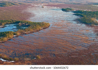 Aerial view of the impassable Siberian marshes during spring snow melting.