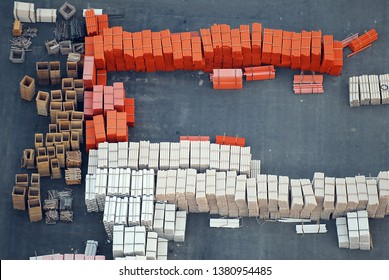 Aerial view of industrial building material, PVC pipes and plastic material stacked on a construction site