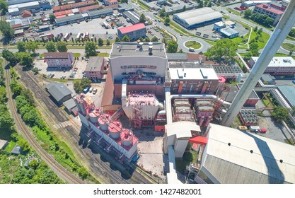 Aerial view of industrial heating plant complex in the city.