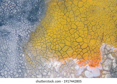 Aerial view industrial place. Dry surface. Desertic landscape. Human impact on the environment. View from above. Abstract industrial background.