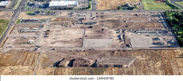 An aerial view of the infrastructure and underground utility construction for a shopping center at a commercial real estate development.