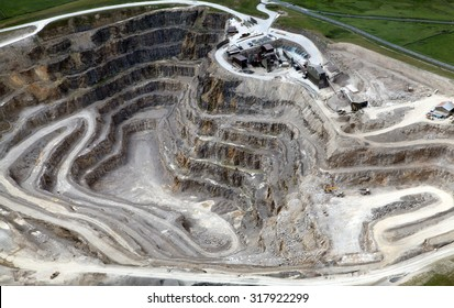 aerial view of the inside of a deep stone quarry in England, UK