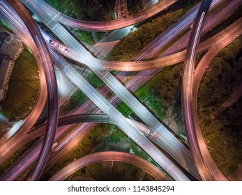 Aerial View of Interchange - Transport concept image. Long exposure birds eye view use the drone, shot in Zhubei City, Hsinchu, Taiwan.