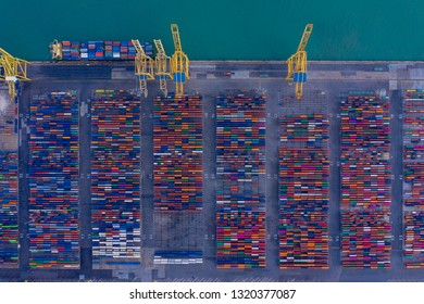 Aerial view to a lot of intermodal shipping container are in a port. cargo transportation system on ships. Graphic view of multi-colored containers on top. equipment and cranes