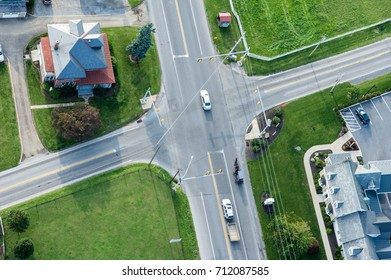 An aerial view of an intersection with traffic.