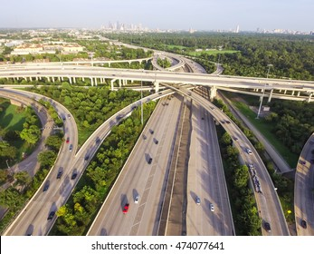 Aerial view interstate 10, Katy freeway and downtown with massive intersection, stack interchange and elevated road junction overpass at late afternoon from the west side of Houston, Texas, USA.